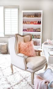 a home office. a fluffy and feminine home office with stocked shoe shelf