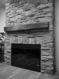 interior grey wooden bar fireplace mantels of grey stone fireplace having black metal firebox on