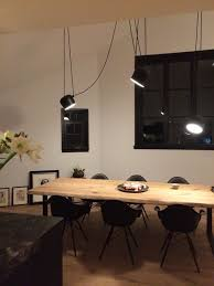 flos lighting soho. flos aim pendant lighting brightens up the night in this spacious kitchen with a large window, white walls, wooden table and hardwood floors. flos soho