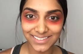 red lipstick on dark under eye circles