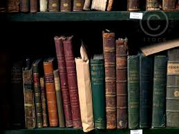 dusty old book volumes d on shelf 2556