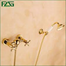 golden bathroom shower column faucet wall: flg wall mounted bathtub faucet with ceramic hand shower waterfall bath faucet brass gold plated finish