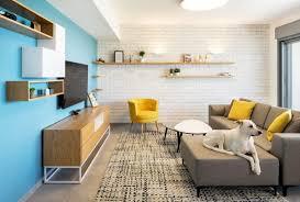 white bricks blue wall apartment by