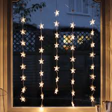 How To Decorate Window With Lights 40 Warm White Led Star Curtain Light