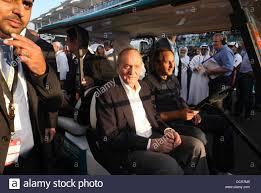 Juan Carlos, Re di Spagna in F1 con griglia di partenza con una Golf Caddie  guidato da Gerhard Berger Formula 1 Gran Premio di Abu Dhabi Abu Dhabi,  Emirati Arabi Uniti -