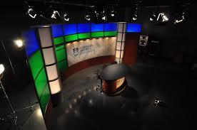 northern arizona university broadcast set design simple backdrop