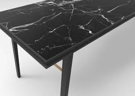 aes desk this unique desk consists of a metal collar with nero marquina marble top