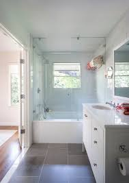 white bathrooms with dark floors. glass tile countertop bathroom traditional with floor shower tub white bathrooms dark floors