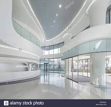 Curved Architecture Curved And Glazed White Interior Of Reception Sky Soho Shanghai