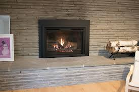 a new heat glo gas fireplace insert from heat glo with very realistic looking