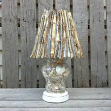 lighting shade. give it a rusted outdoor look with twigs lighting shade