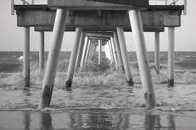 Pier in Surf Photograph by Ivan Franklin