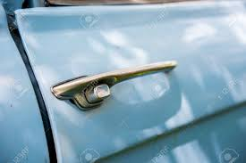 Old Chrome Car Door Handle Bar Close Up Image On Rusty Body Vintage