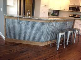 reclaimed barn tin roofing used as under a bar cabinet with metal pipe old for