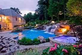 pool lighting design. fire and fiber optic lighting enhance the backyard showcase well after sundown pool lighting design