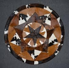designer round cowhide rug