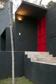 red door grey house. Beautiful Touch Of Décor In Modern Residence : Great Exterior Calero House With Grey Wall Design Red Door