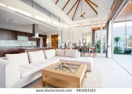 Luxury interior design in living room of pool villas. Airy and bright space  with high