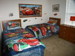 admirable disney cars bedroom room ideas with colorful cars bedding sets and brown wooden cabinet plus red table lamp shade