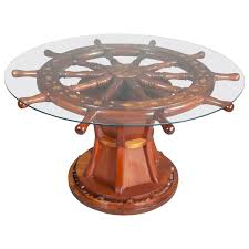 round glass top coffee table with nautical ship wheels base design decofurnish