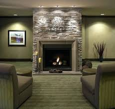 mount tv on stacked stone fireplace living room beige area rugs wall television black wood