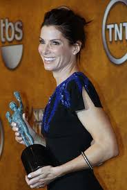 sandra bullock seems to be aging backwards there s no other way to describe sandra bullock s skin except as smooth and dewy being her next door