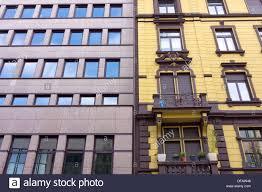 Facade Of A Modern Apartment Building Beside An Old Apartment - Modern apartment building facade
