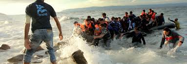 essays on america s future refugees migration and national  photo of refugees arriving by boat on a beach