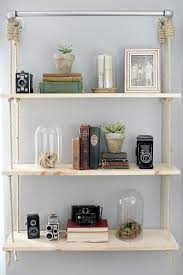 show off your collection of accessories with hanging wood shelves