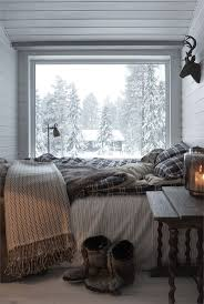 A warm bed with a great view in a secluded snowy cottage.