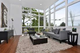 ... Rugs Living Room, Large Window And Grey Sofa Plus Cushions Facing Dark  Table On Living Room ...