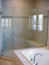 door frameless partial neo angle shower enclosure with large panel on tub deck and no header