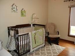 cute baby boy room ideas with beige wall painted also wooden crib and grey rugs on wood floors added rocking chairs tips