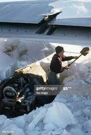 Bob Vanderveen digs out the aircraft heater from the winter snows ...