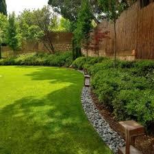 backyard landscaping design. Photo Of A Contemporary Partial Sun Backyard Landscaping In Madrid. Design