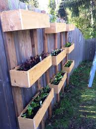Hanging planter boxes on the fence. This is really taking advantage of all  available space.