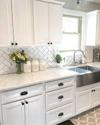 white tile kitchen backsplash white kitchen kitchen decor subway tile  herringbone subway tile luxurious white kitchen