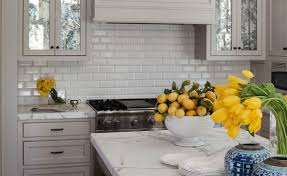 this ceramic tile backsplash compliments the stone perfectly