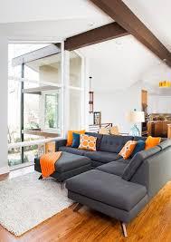 gray and orange living room. grey sofa mid century living room | rug atlanta blue cable railing fireplace gray and orange i