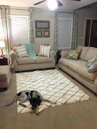 put area rug on top of carpet