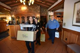 olive garden restaurant employees sky diaz lucie anderson and manager steve mcelhenny on their way to deliver free lunch to riverside firefighters on labor