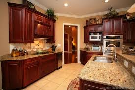 Kitchens With Cherry Cabinets Mesmerizing Cherry Kitchen Cabinets With Gray Wall And Quartz Countertops Ideas
