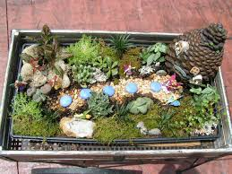 pinner says fairy garden found the cart fairies at hobby lobby tray plants soil at home depot so easy and so cute