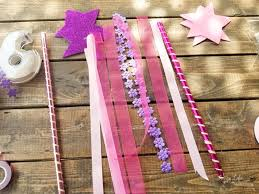 cut out the ribbons so they are the length of the wand my daughter demanded the ribbon be the same length of the wand