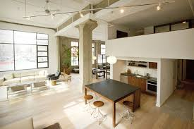 With soaring ceilings and great natural light, this historic 2,200 square  foot loft has a completely remodeled interior space.