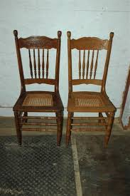 2 antique oak pressed back cane seat dining room side