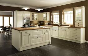 cream colored kitchen cabinets with white appliances cream kitchen cabinets black granite countertops