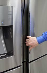 refrigerator handles. recessed handles give the samsung rf23j9011sr a smooth, futuristic look. refrigerator