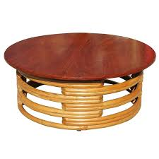 red round rattan coffee table with mahogany top