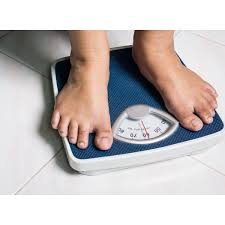 woman standing on scale and to check weight zantrex 3 is a t supplement manufactured by zoller laboratories